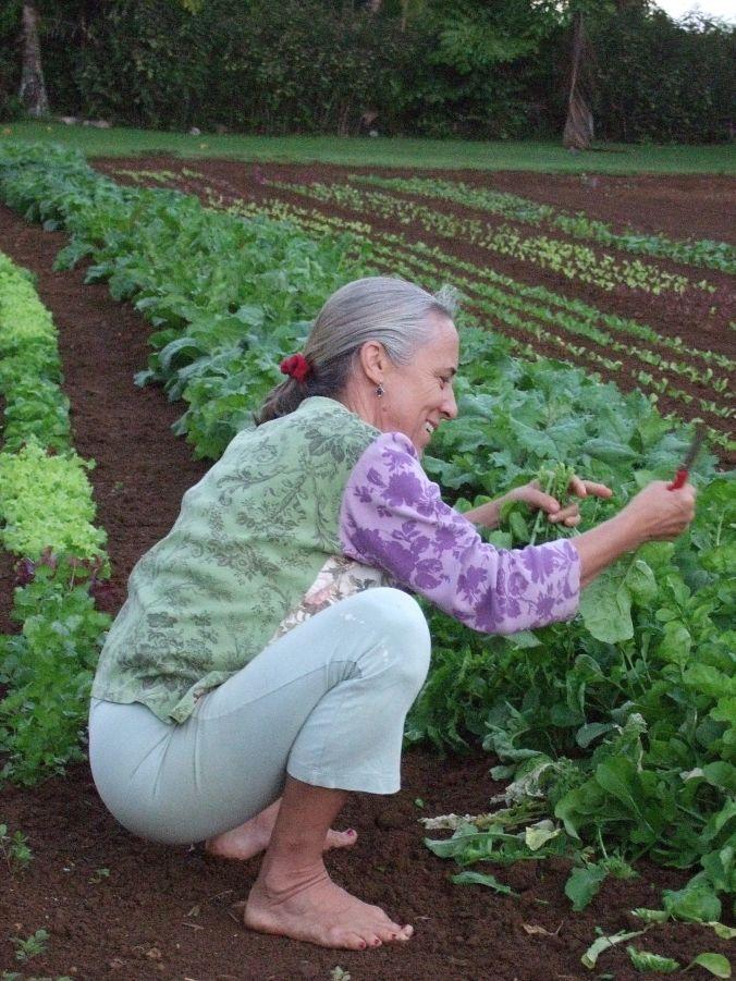 lee squatting in garden